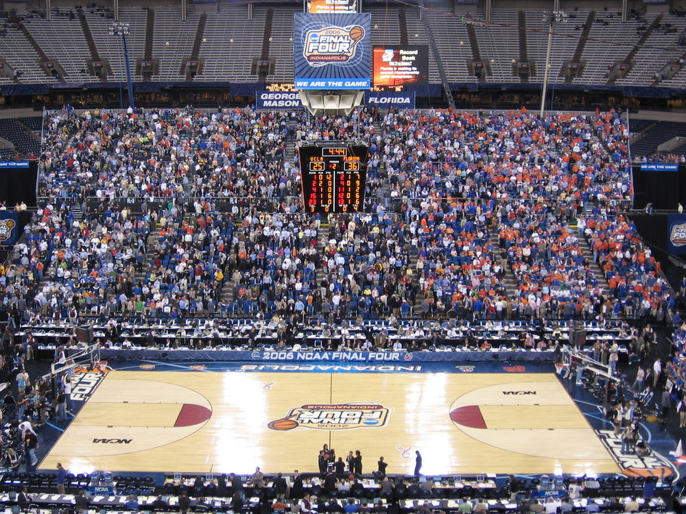 Fans in the stands at a March Madness basketball game