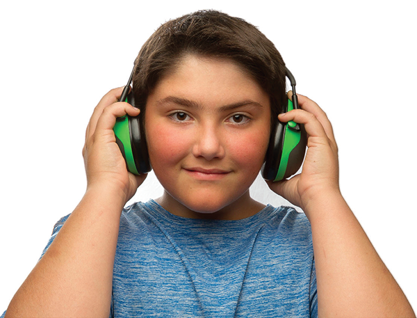 A teenage boy wearing earmuffs used to protect hearing.