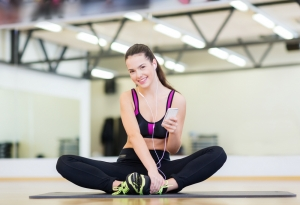 Woman in gym listening to a music player