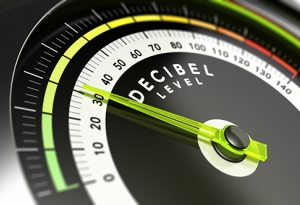 Decibel measurement gauge with green needle pointing to 30 dB