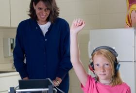 School nurse interacting with student