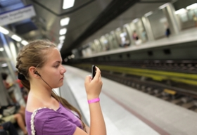 Girl in subway station wearing earbuds